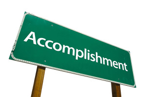 bigstockphoto_accomplishment_-_road_sign_273784811